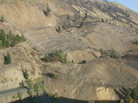 Highway 410 is buried beneath tons of dirt from a landslide that began Sunday morning and continues to move. Photo: DNR