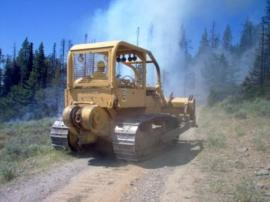 Bulldozer clearing a firebreak on the Maxwell Fire (2006). Photo: DNR