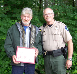 Frank Venske, volunteer, and Chief Larry Raedel, DNR