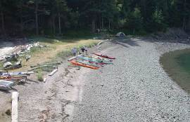 Kayaks on beach at Cypress Head campground.