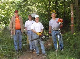 Volunteers pause for a photo during a work party at Walker Valley ORV Trail System. Photo: Elyse Fleenor/DNR.