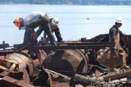 Working to remove creosote-treated pilings and garbage in Puget Sound is ana example of the work Puget Sound Corps crews will be involved with. Photo: DNR