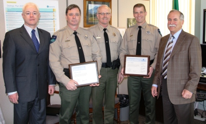 Commissioner Peter Goldmark and law enforcement staff