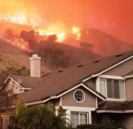 Wildfire approaches housing development
