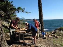 Volunteers build a new table at Lummi Island NRCA at the 2010 National Public Lands Day event.