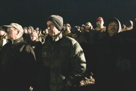 Firefighters rise before 6 a.m. for morning briefing at fire camp.