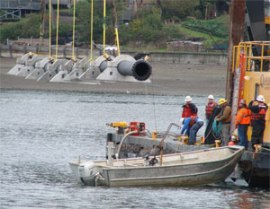 Crews get ready to drop a new outfall extension into place for Shelton's new wastewater treatment plant. Photo: City of Shelton