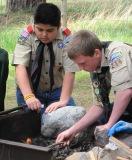 7-boy-scout-lights-campfire