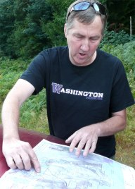 Assistant Region Manager, Doug McClelland goes over a map on a committee field visit in Snoqualmie Corridor. Photo: Bob Pattie