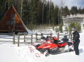 Paul Coppock arrives at Hunters Meadow Cabin after a day of snowmobile riding. Photo: Ken Orford.