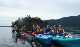 Kayakers paddle to Cypress Island NRCA. Photo Jason Goldstein, DNR.