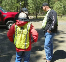 Forest Watch Volunteers provide information to the public and report any safety concerns. Photo: Greg Mackey, DNR.
