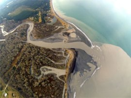Aerial photo of the Elwha River delivering sediments to the Straits of Juan de Fuca. Photo: Tom Roorda