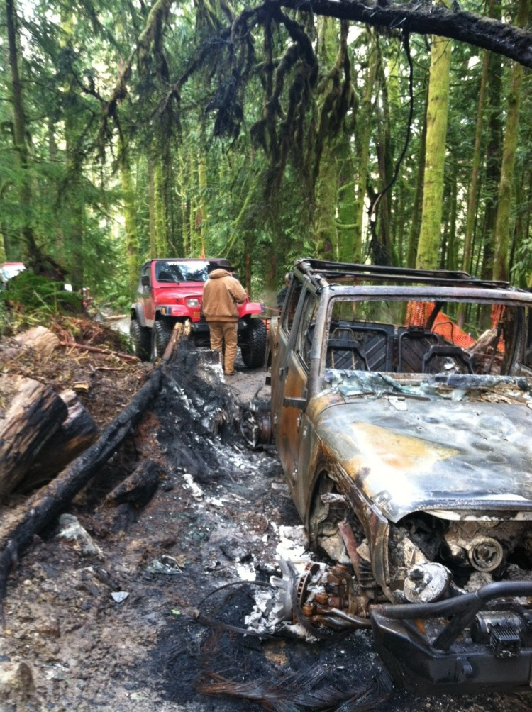 scorched vehicle being towed out after car fire in walker valley