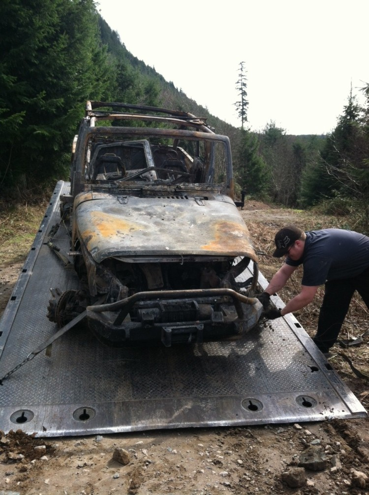 Scorched jeep is towed out of Walker Valley ORV.
