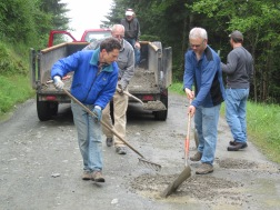 Volunteers help with a temporary fix to the roads up to the Blanchard Forest. Photo: Diana Lofflin, DNR.