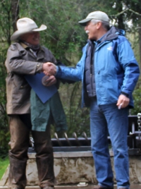 Commissioner of Public Lands Peter Goldmark shakes the hand of Ron Downing as he receives a Volunteer Hero Award. Photo: Dana Leavitt, DNR.