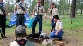 Boy Scouts learn how to properly put out their campfire