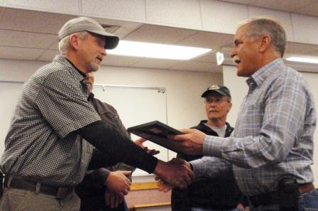 Peter Goldmark presents special commendations to DNR employees