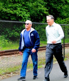 Commissioner of Public Lands Peter Goldmark and Governor Jay Inslee cross the finish line to complete their wildfire work capacity test.