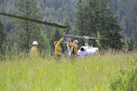 Helitack crew ties down the rotor for safety when the helicopter is not in use. PHOTO: Janet Pearce