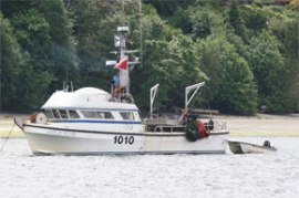 Photo of a geoduck harvest boat.