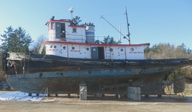 Uninsured, unmaintained once-fine-old tug hauled out of water before disposal.