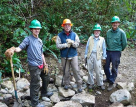 volunteers building trails