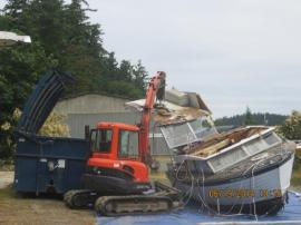Contractors destroy an old boat turned in as part of DNR's new Vessel Turn-In Program. Photo by DNR.