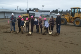 Ocosta students use golden clam guns to break ground on a new school that will double as a tsunami evacuation structure at Westport.