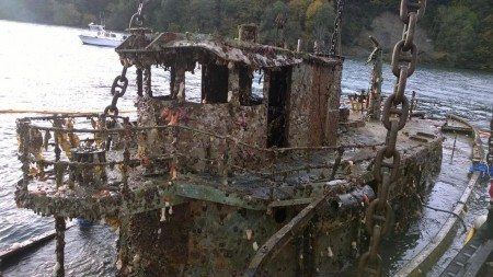 It wasn't a pretty site when the Murph, a 70-year-old derelict tug boat posing a navigation hazard in Quartermaster Harbor, was pulled to the surface last year. It took two days to retrieve the 100-foot-long vessel. Photo: DNR.