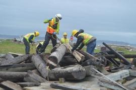 DNR restoration crews prep logs for disposal. Photo: Joe Smillie, DNR.