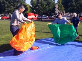 Gov. Jay Inslee and Commissioner Goldmark trained for the coming fire season by practicing their fire shelter deployment skills at Capitol Lake June 10. DNR Photo