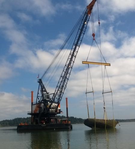 DNR contractors remove the Atlantis from Dockton Harbor off Vashon Island. DNR Photo