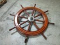 Items recovered from derelict vessels like this helms wheel can be bid on through the state's surplus auction site.