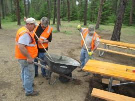Volunteers install new picnic tables at Teanaway Campground. Photo/ DNR.