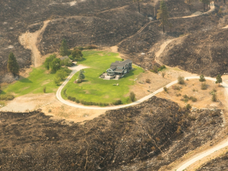This house was saved from the Chelan Complex Fire because it had defensible space. Photo Kari Greer/USFS