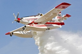 FIre Boss, such as this single engine airtanker, can scoop up water quickly. Photo DNR