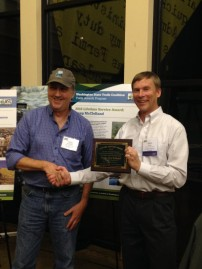 Doug McClelland receiving Washington State Trail Coalition's lifetime service award. Photo courtesy of Mountains to Sound Greenway Trust.