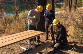 A Washington Conservation Corps crew installs a picnic table at Leader Lake. Photo: DNR.