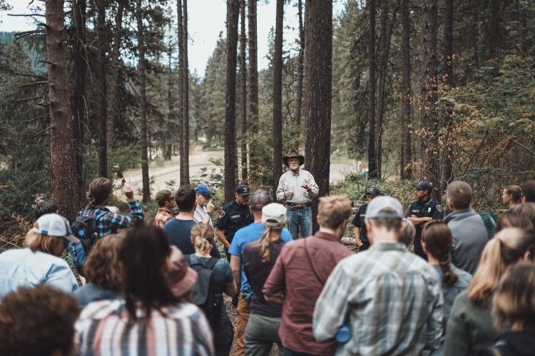Tree farmer Ross Frank, former chair of the Chumstick Wildfire Stewardship Coalition, talks to members of The Nature Conservancy in June at the Red-Tail Canyon Farm in Leavenworth. The Chumstick coalition facilitated the meeting, allowing members of The Nature Conservancy to meet potential forest health partners in Washington state. (The Nature Conservancy photo)